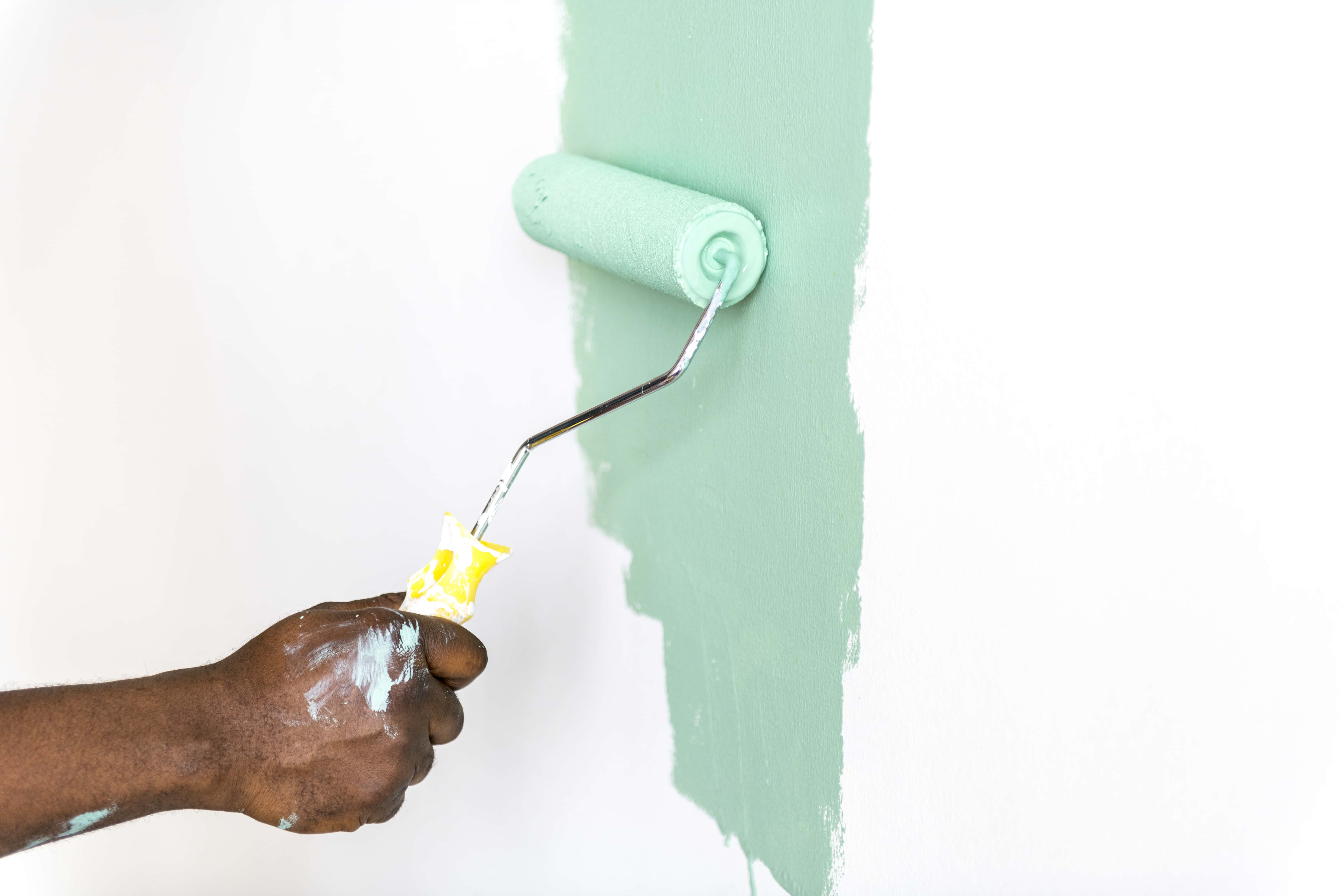 People painting house wall